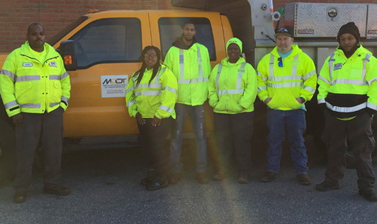 A Salisbury Maintenance team replaced a rusting culvert on MD 349. Pictured, left to right, are Alvin Christopher, Pamela Whittington, Everett Fields, Jr., Tonya Bunting, Joshua Parker, and Daiyon Johnson.