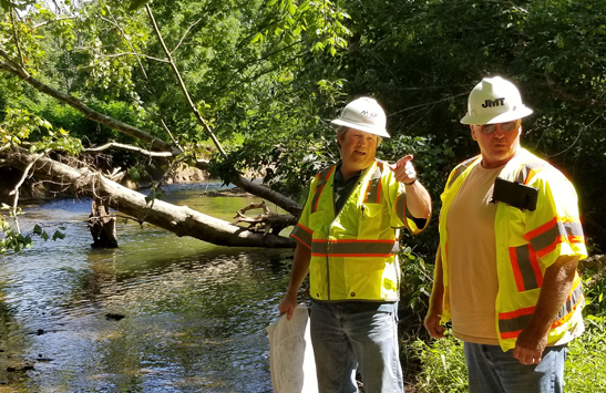 It was easier to explain the MD 355 project to a customer in person, says, D7 Construction Project Engineer Philip Brentlinger, left, shown here discussing related stream restoration with a contractor.
