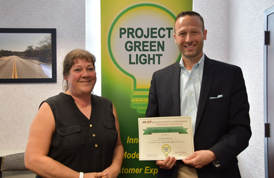 Andrea Dufrenne (shown with MDOT SHA Administrator Greg Slater) recently received approval for her plan to improve employee collaboration.