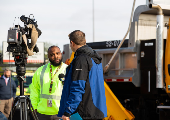 During our annual Snow Show about winter preparations, Glen Burnie Team Leader/FMIT IV Quinole (Kevin) Abney let reporters take a swing behind the wheel of a snowplow and then granted an interview to WBAL-TV reporter Lowell Melser.