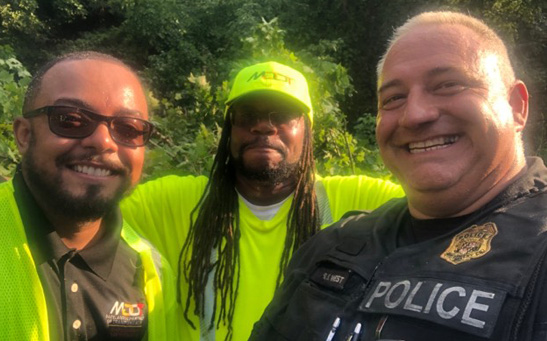 Pierre Patterson (left) and Sean Maddox earned customer service kudos from Maryland State Police Officer Scott West for their swift cleanup of a roadway after a storm.